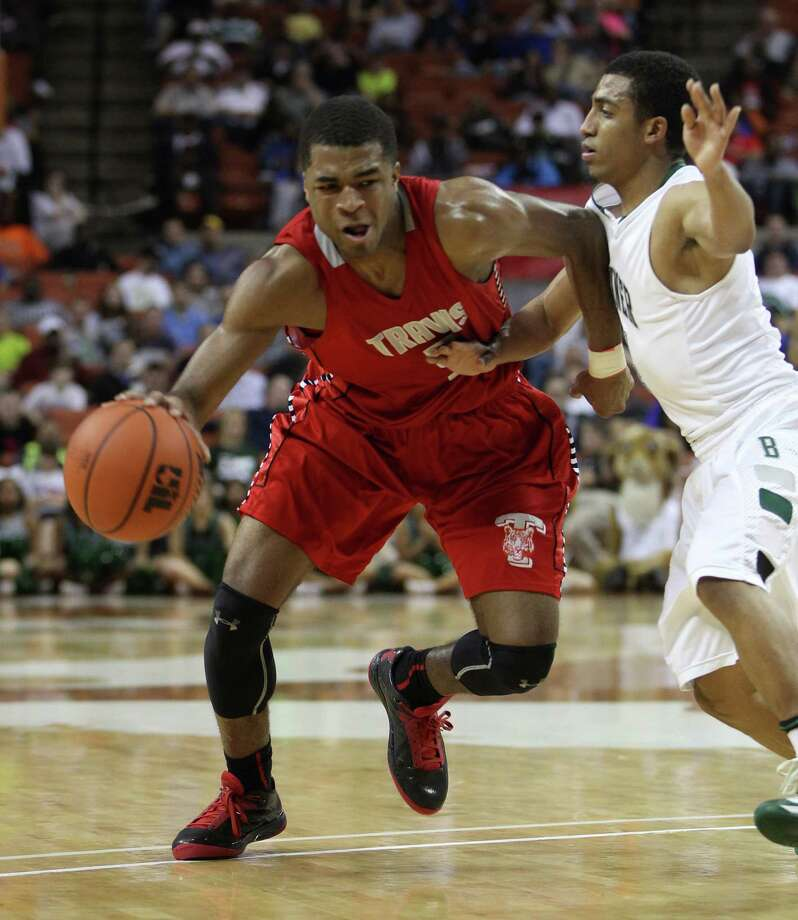 Travis' Andrew Harrison (5) moves past Berkner's Rishaard Jackson (14) during the second half. Photo: Karen Warren, Houston Chronicle / © 2013 Houston Chronicle