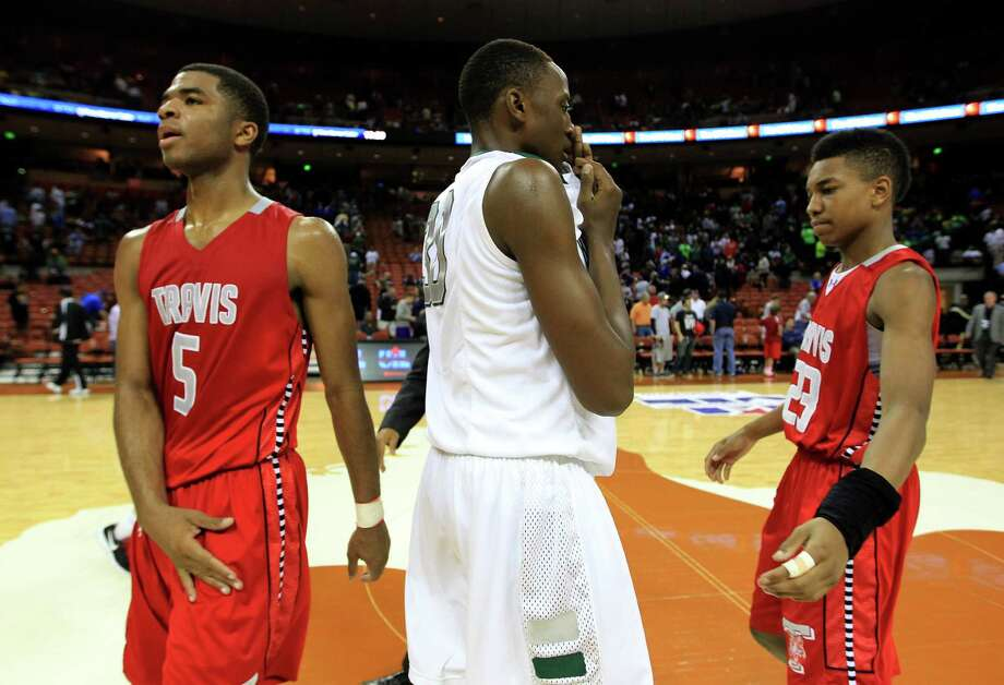 5A state semifinalsTravis 60, Richardson Berkner 52Berkner's Robert Johnson reacts as he passes Travis' Andrew Harrison (5) and Tyronne Jordan (23) after their win in the  UIL 5A boys state basketball semifinals. Photo: Karen Warren, Houston Chronicle / © 2013 Houston Chronicle