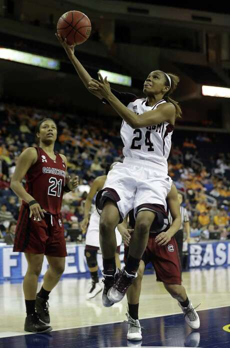 A&M guard Jordan Jones lays up a shot during the second half against South Carolina in the SEC tournament quarterfinals. The Aggies will face Tennessee in the semifinals today. Photo: John Bazemore / Associated Press