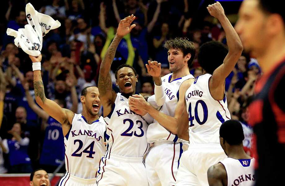 Kansas players (from left) Travis Releford, Ben McLemore, Jeff Withey and Kevin Young celebrate after Withey hit a 3-pointer against Texas Tech on Monday in Lawrence, Kan. Photo: Jamie Squire / Getty Images