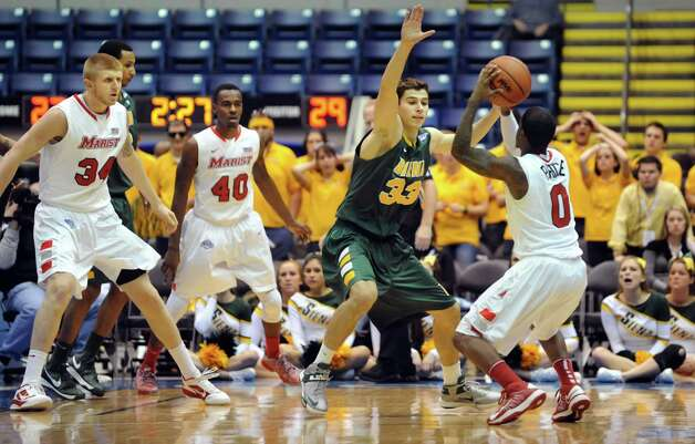 Siena's Rob Poole (33), center, goes up against Marist's Devin Price (0), right, during their first round MAAC Championship basketball game on Friday, March 8, 2013, at MassMutual Center in Springfield, Mass. (Cindy Schultz / Times Union) Photo: Cindy Schultz / 10021490A