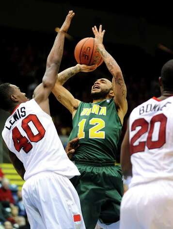 Siena's Rakeem Brookins (12), center, shoots and draws a foul from Marist's Chavaughn Lewis (40), left, during their first round MAAC Championship basketball game on Friday, March 8, 2013, at MassMutual Center in Springfield, Mass. Siena wins 70-64. (Cindy Schultz / Times Union) Photo: Cindy Schultz / 10021490A