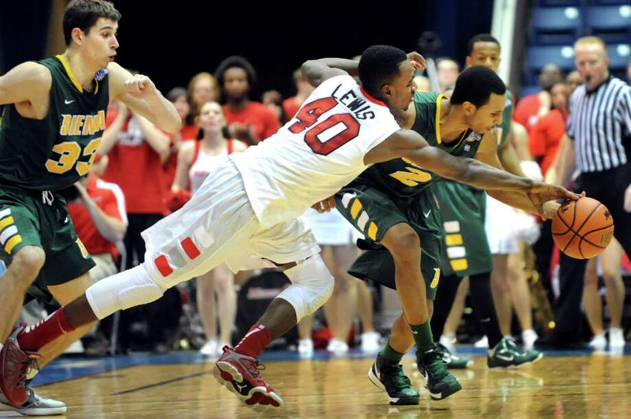 Siena's Trenity Burdine (2), right, battles for a loose ball with Marist's Chavaughn Lewis (40) during their first round MAAC Championship basketball game on Friday, March 8, 2013, at MassMutual Center in Springfield, Mass. (Cindy Schultz / Times Union) Photo: Cindy Schultz / 10021490A