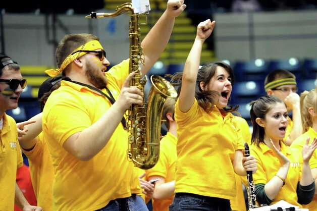 Siena's Pep Band cheers when their team pulls ahead in the final seconds of their first round MAAC Championship basketball game against Marist on Friday, March 8, 2013, at MassMutual Center in Springfield, Mass. (Cindy Schultz / Times Union) Photo: Cindy Schultz / 10021490A