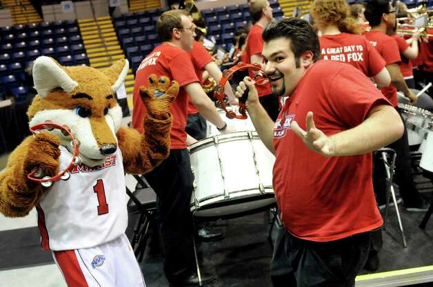 Marist Pep Band percussionist Derek Daffara, 19, right, dances with the Red Fox before their first round MAAC Championship basketball game against Siena on Friday, March 8, 2013, at MassMutual Center in Springfield, Mass. (Cindy Schultz / Times Union) Photo: Cindy Schultz / 10021490A