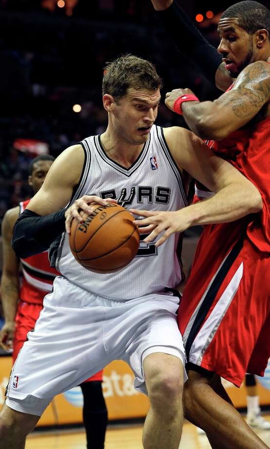 Tiago Splitter moves on LaMarcus Aldridge as the Spurs play the Portland Trail Blazers at the AT&T Center on March 8, 2013. Photo: TOM REEL