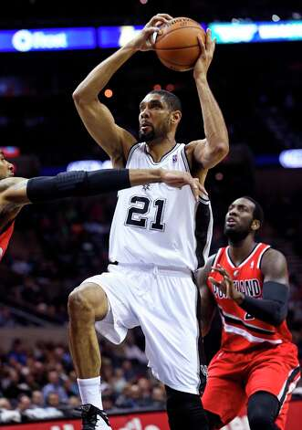 Tim Duncan takes the ball coast to coast in the first quarter as the Spurs play the Portland Trail Blazers at the AT&T Center on March 8, 2013. Photo: TOM REEL