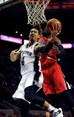 Danny Green gets away from J.J. Hickson in the first half as the Spurs play the Portland Trail Blazers at the AT&T Center on March 8, 2013. Photo: TOM REEL