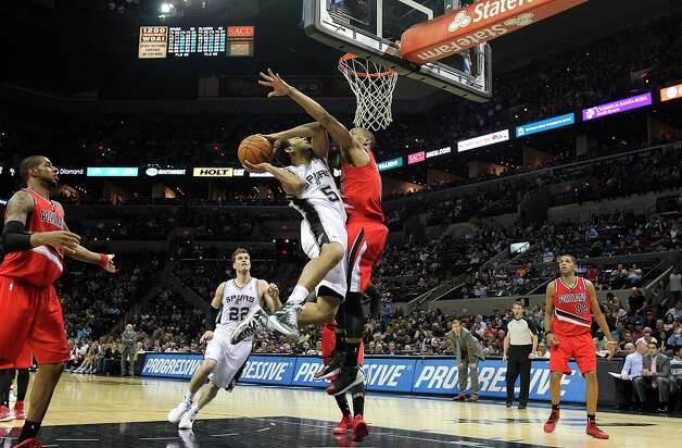 Cory Joseph gets to the hoop against Damian Lillard as the Spurs play the Portland Trail Blazers at the AT&T Center on March 8, 2013. Photo: TOM REEL