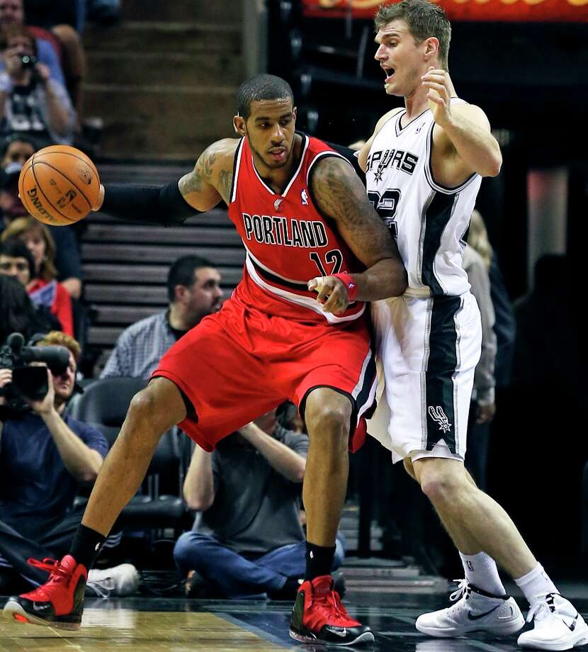 LaMarcus Aldridge makes a move on Tiago Splitter as the Spurs play the Portland Trail Blazers at the AT&T Center on March 8, 2013. Photo: TOM REEL