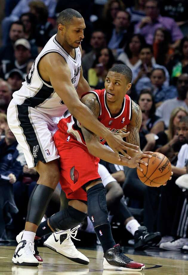 Boris Diaw defends out front against Damian Lillard as the Spurs play the Portland Trail Blazers at the AT&T Center on March 8, 2013. Photo: TOM REEL