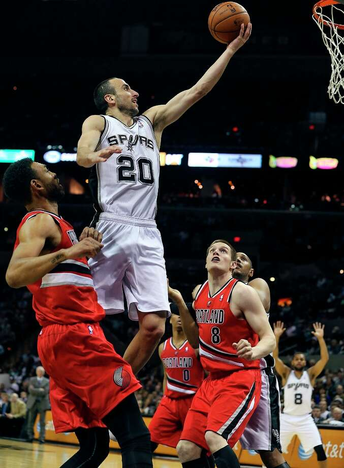 Manu Ginobili rolls into the basket for points in the second half as the Spurs play the Portland Trail Blazers at the AT&T Center on March 8, 2013. Photo: TOM REEL