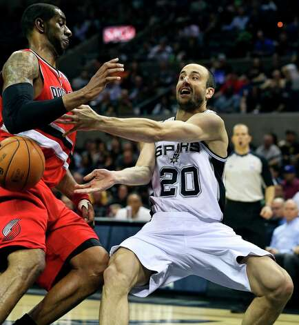 Manu Ginobili passes away after running into LaMarcus Aldridge in the lane as the Spurs play the Portland Trail Blazers at the AT&T Center on March 8, 2013. Photo: TOM REEL