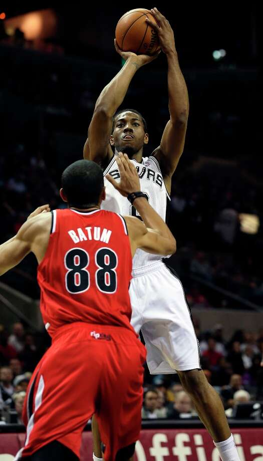 Kawhi Leonard pulls up for a jumper in front of Nicolas Batum as the Spurs play the Portland Trail Blazers at the AT&T Center on March 8, 2013. Photo: TOM REEL