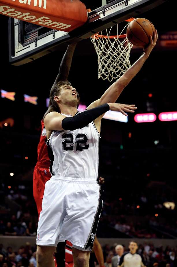 Tiago Splitter goes underneath to get the hoop as the Spurs play the Portland Trailblazers at the AT&T Center on March 8, 2013. Photo: TOM REEL
