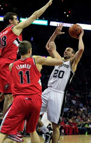 Manu Ginobili pulls up for a jumper as the Spurs play the Portland Trail Blazers at the AT&T Center on March 8, 2013. Photo: TOM REEL