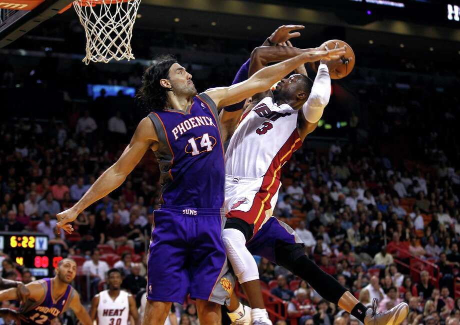 Luis Scola, left, will do his best to take feelings out of the equation, but he knows it will be tough not to have his emotions go into overdrive when facing the Rockets tonight and especially Wednesday at Toyota Center. Photo: J Pat Carter, STF / AP