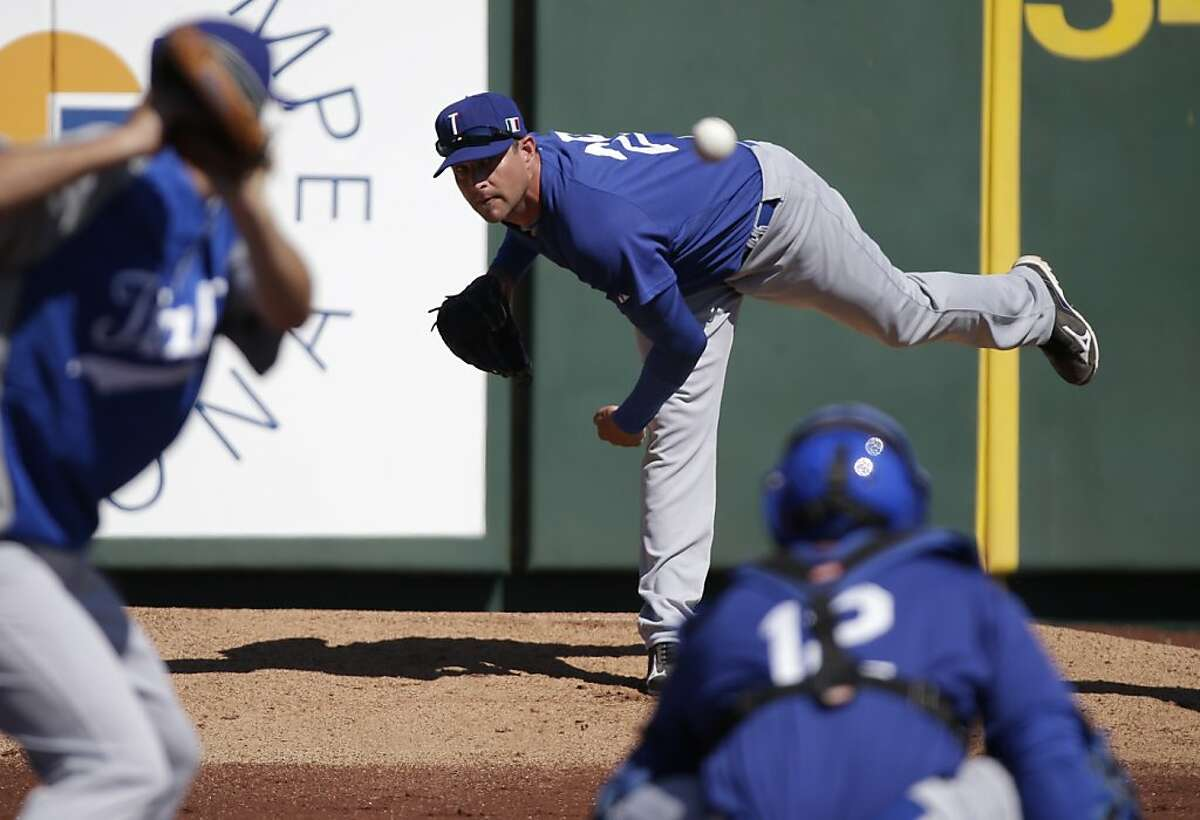 Italy's Dan Serafini throws before the first inning of an exhibition spring training baseball game against the Los Angeles Angels Wednesday, March 6, 2013, in Tempe, Ariz. (AP Photo/Morry Gash)