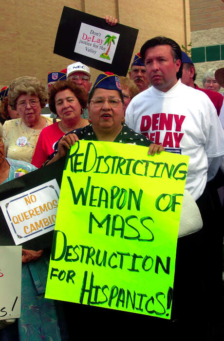 Susie Luna-Saldana, center, with the American G.I. Forum from Corpus Christi, protests the Texas House subcommittee meeting on congressional redistricting at the University of Texas at Brownsville campus, Thursday, June 26, 2003. With a special session just four days away, a House committee began taking public input on a bill to redesign the state's congressional districts in favor of Republicans. (AP Photo/Brownsville Herald, Brad Doherty)   HOUCHRON CAPTION (06/27/2003):  At the University of Texas at Brownsville on Thursday, Susie Luna-Saldana, center, protests a House subcommittee meeting on congressional redistricting. Photo: BRAD DOHERTY, MBR / BROWNSVILLE HERALD