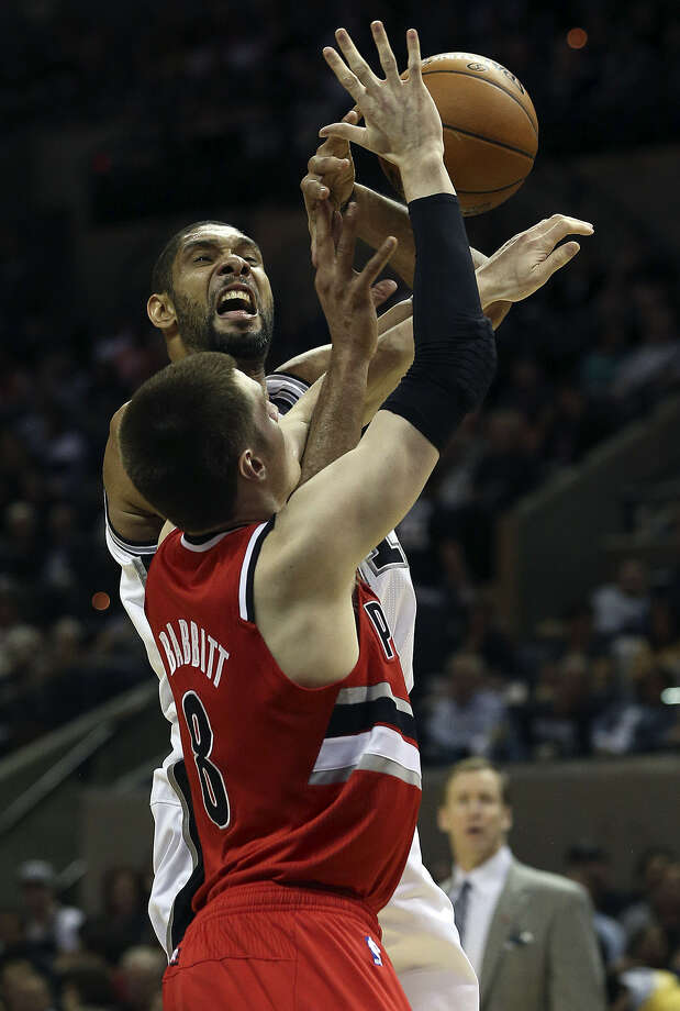 Tim Duncan and Co. struggled Friday against Luke Babbitt and the Trail Blazers, who handed the Spurs their worst home loss since Duncan joined the team. Photo: Tom Reel / San Antonio Express-News