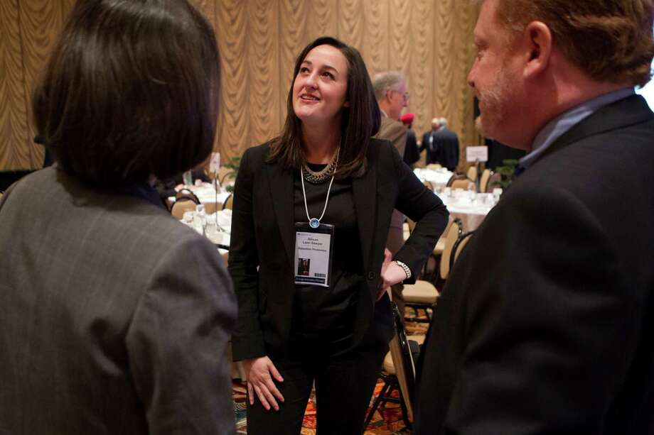 Allison Lami Sawyer, CEO with Rebellion Photonics, talks with attendees after a roundtable discussion featuring Energy Innovation Pioneers at IHS CERAWeek 2013 Wednesday, March 6, 2013, in Houston. ( Johnny Hanson / Houston Chronicle ) Photo: Johnny Hanson, Staff / © 2013  Houston Chronicle