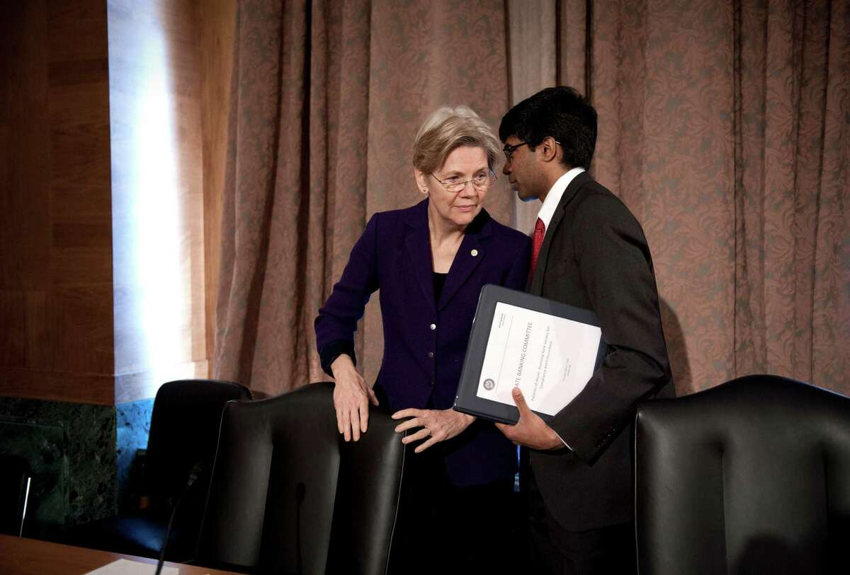 Sen. Elizabeth Warren, D-Mass., confers with Ganesh Sitarama, her senior counsel, after attending a Senate Banking Committee hearing on anti-money laundering, on Capitol Hill in Washington, Thursday, March 7, 2013. Warren rose to national prominence as an outspoken consumer advocate decrying Wall Street abuses and became the progressive movement?s darling candidate in last fall?s Senate elections. Like most freshman lawmakers, the Massachusetts Democrat has maintained a low profile during her first few months in office, but that?s starting to change. (AP Photo/Cliff Owen)