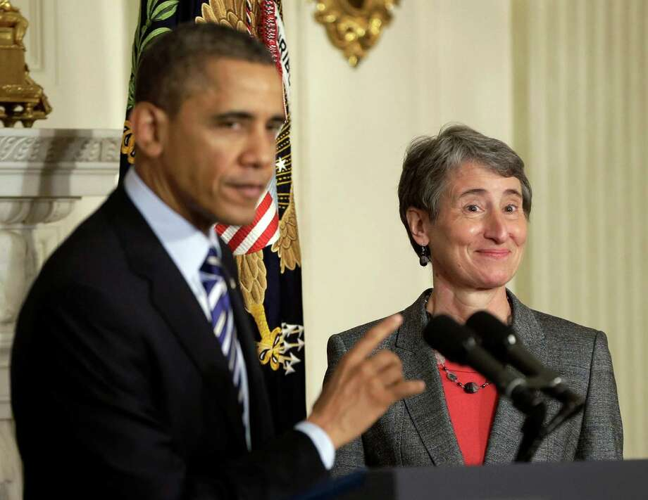 FILE - In this Feb. 6, 2013 file photo, President Barack Obama points towards REI CEO Sally Jewell as he announces that he is nominating her as the next interior secretary replacing outgoing Interior Secretary Ken Salazar, in the State Dining Room of the White House in Washington. (AP Photo/Pablo Martinez Monsivais, File) Photo: Pablo Martinez Monsivais, STF / AP