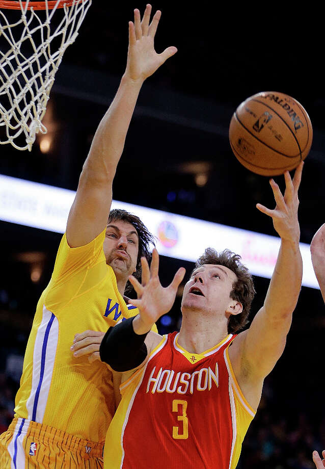 March 8: Rockets 94, Warriors 88Rockets center Omer Asik shoots over Andrew Bogut of the Warriors. Photo: Ben Margot