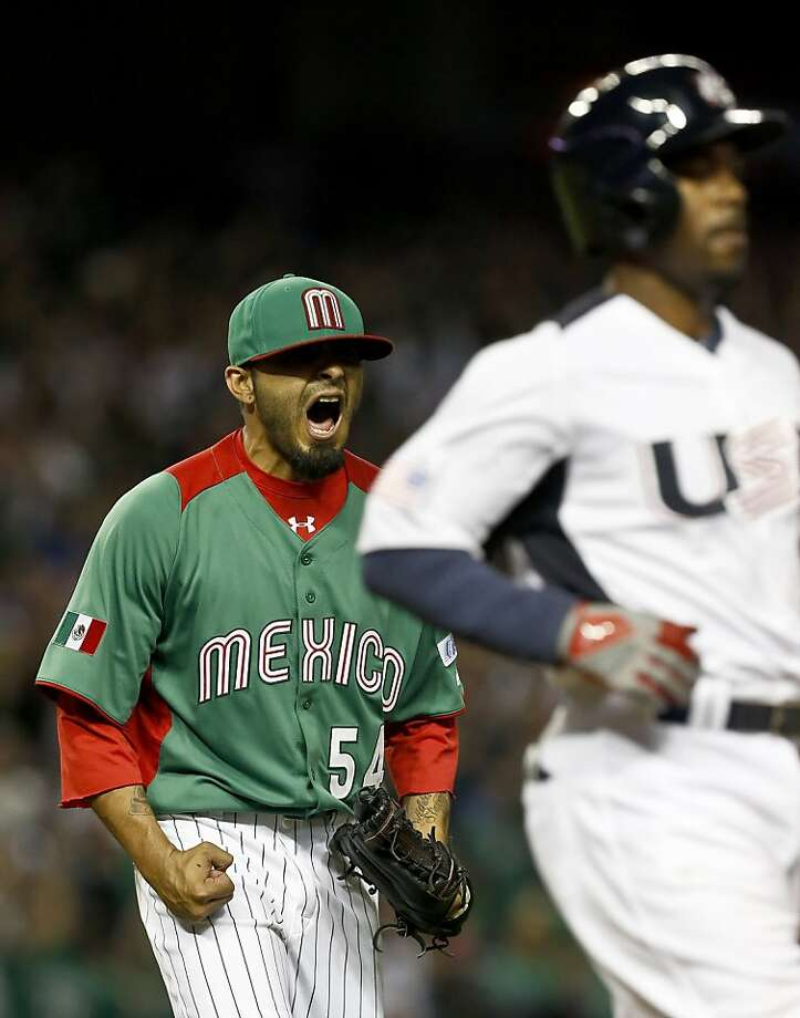 Mexico's Sergio Romo (54) shouts as he watches the final out at first base as United States' Jimmy Rollins grounds out for the final out in a World Baseball Classic baseball game on Friday, March 8, 2013, in Phoenix.  Mexico defeated the United States 5-2. (AP Photo/Ross D. Franklin) Photo: Ross D. Franklin, Associated Press