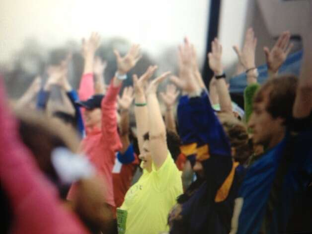Social media snapshots from the starting line of the Gusher Marathon, Half Marathon & 5K on Sat., March 9, 2013. Photo: #BMTGusher Tweets