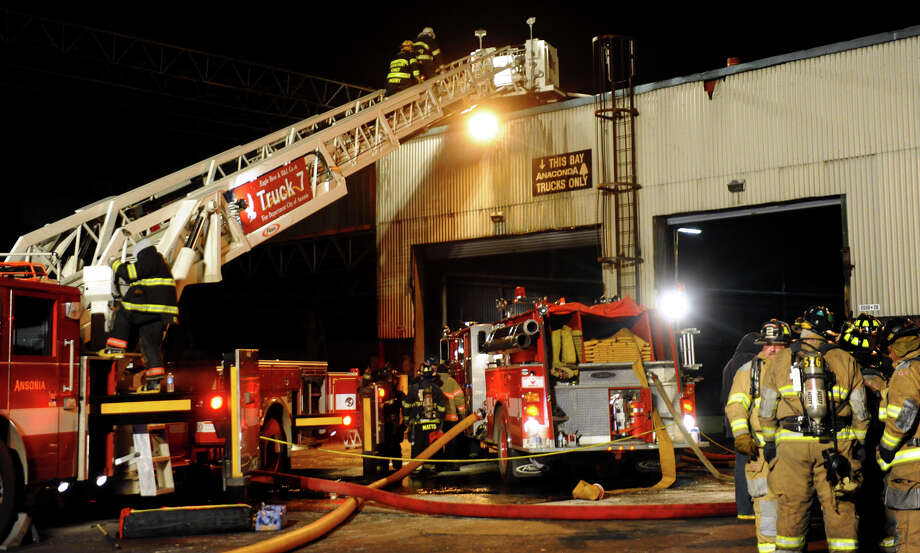 Firefighters are shown on the scene of a blaze at Ansonia Copper and Brass in Ansonia in January. Ansonia will receive a $17,100 grant from the Department of Homeland Security to purchase two thermal-imaging cameras. The city's volunteer firefighters found themselves battling the stubborn, chemical-fueled blaze at the Ansonia Copper factory in which the new technology would have come in handy.