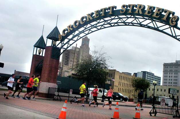 Gusher Marathon and Half Marathon runners breezing through downtown Beaumont on Sat., March 9, 2013. Photo: Mike Tobias