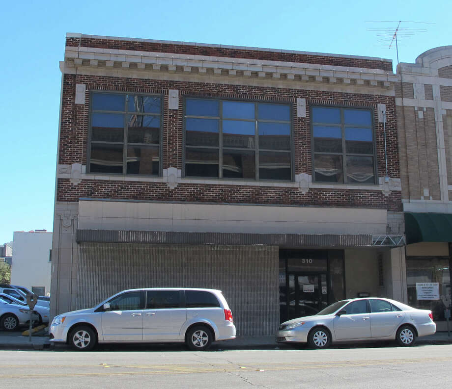 The former Firestone Tire and Rubber Building, 310 Broadway, was constructed in 1917 by H.A. Reuter, just like its neighboring building on Broadway and Third.