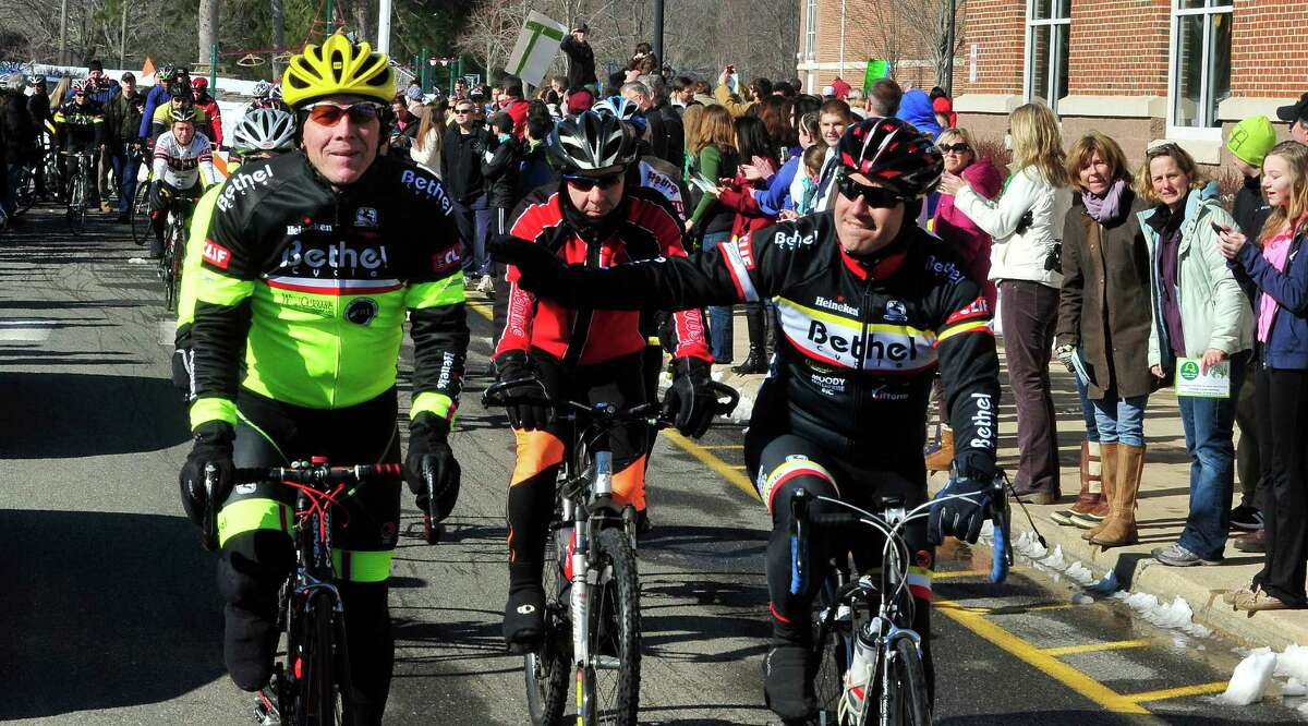 Team 26 and supporting riders, including Jay Moody, left, leave Reed Intermediate School in Newtown, Conn. Saturday, March 9, 2013 on the Sandy Hook Ride to Washington, D.C., to support gun control legislation.