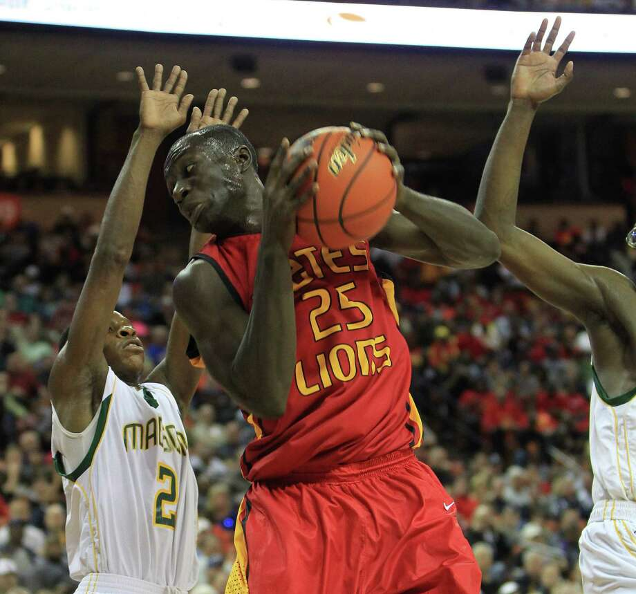 Yates Sadiq Inuwa (25) battles for a rebound against Dallas Madison's Cameron Bryant (2) during the first half of the UIL 3A boys state basketball final game between Dallas Madison and Houston Yates at the Frank Erwin Center, Saturday, March 9, 2013, in Austin. Photo: Karen Warren, Houston Chronicle / © 2013 Houston Chronicle