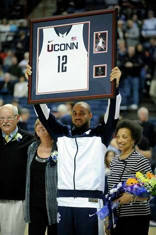 Connecticut graduate student R.J. Evans celebrates Senior Day before an NCAA college basketball game against Providence in Storrs, Conn., Saturday, March 9, 2013. (AP Photo/Fred Beckham)