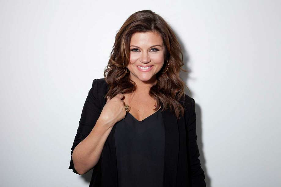 "This Feb. 6, 2013 file photo shows actress Tiffani Thiessen posing for a portrait in New York. Thiessen, best known for her former role as Kelly Kapowski on TV's ""Saved by the Bell,"" says she had no idea at the time of how popular the show was. She says she's grateful she grew up in the limelight before TMZ and other 24 hour media outlets and gossip blogs came along. She currently stars in the USA series ""White Collar."" (Photo by Amy Sussman/Invision/AP) Photo: Amy Sussman"