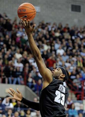 Providence's LaDontae Henton shoots during the first half of an NCAA college basketball game against Connecticut in Storrs, Conn., Saturday, March 9, 2013. (AP Photo/Fred Beckham)