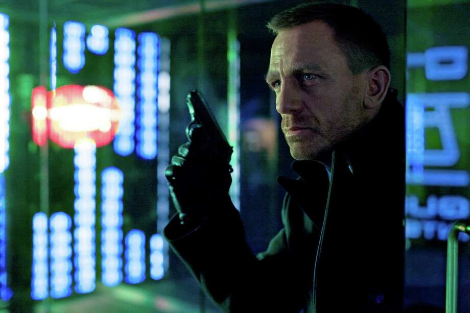 "Daniel Craig as James Bond in the action adventure film, ""Skyfall.""  In the latest James Bond movie, the hero is given a gun that recognizes the palm of his hand. Later, when a bad guy snatches the pistol away in a tussle, it won't fire, and Agent 007 lives to die another day. Photo: Associated Press"