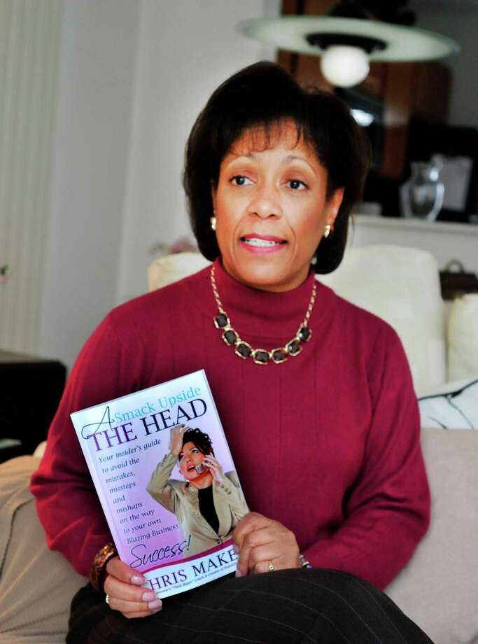 "Danbury resident Chris Makell holds her new book, ""A Smack Upside The Head: Your insider's guide to avoid the mistakes, missteps and mishaps on the way to your own Blazing Business Success!""  Photographed Thursday, March 8, 2013 in Conn. Photo: Michael Duffy / The News-Times"