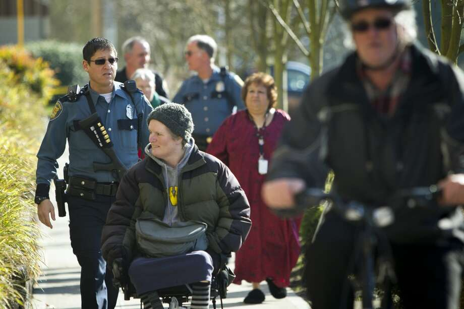 Police block off street access to civilians near the Bitter Lake Community Center in North Seattle, Friday, March 8, 2013.