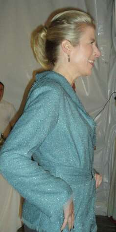 Kristin Kolk of Fairfield walked the runway wearing an aqua tweed jacket, one of 66 Jennifer Butler fashions that were showcased Friday in a benefit for the Friends of the Fairfield Public Library.  FAIRFIELD CITIZEN, CT 3/8/13 Photo: Meg Barone / Fairfield Citizen freelance