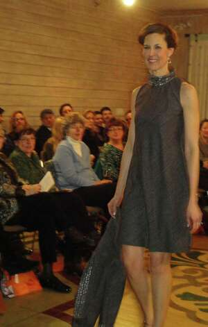 A model wears one of Fairfield designer Jennifer Butler's fashions Friday at a show benefiting the Friends of the Fairfield Public Library.  FAIRFIELD CITIZEN, CT 3/8/13 Photo: Meg Barone / Fairfield Citizen freelance