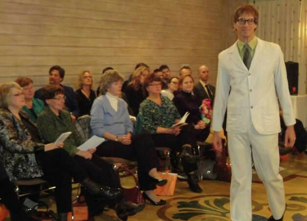 Tim DiScipio models one of Jennifer Butler's designs at a Friday show in the Delamar Hotel benefiting the Friends of the Fairfield Public Library.  FAIRFIELD CITIZEN, CT 3/8/13 Photo: Meg Barone / Fairfield Citizen freelance