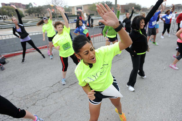 Lisa Chambers dances with a groupin front of the Montagne Center before the Gusher Marathon on Saturday. 2013 Gusher Marathon Photo taken March 09, 2013 Guiseppe Barranco/The Enterprise Photo: Guiseppe Barranco, STAFF PHOTOGRAPHER / The Beaumont Enterprise