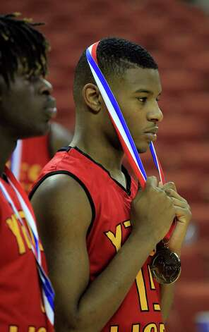 Yates Brandon Hayes pulls the second place medal over his head as he reacts during the awards ceremony after Yates' loss after the UIL 3A boys state basketball final game between Dallas Madison and Houston Yates at the Frank Erwin Center, Saturday, March 9, 2013, in Austin.  Yates lost the game. Photo: Karen Warren, Houston Chronicle / © 2013 Houston Chronicle