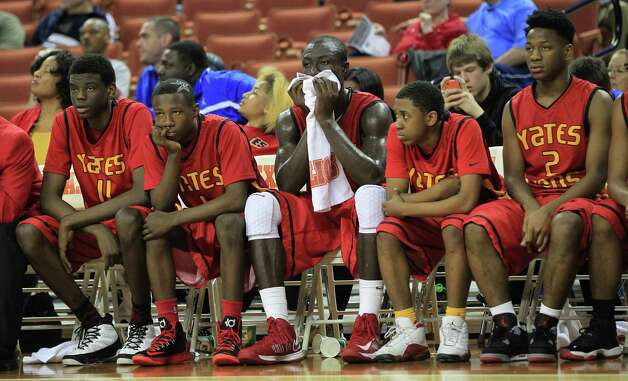 The Yates bench watches the final minute of the game during the second half of the UIL 3A boys state basketball final game between Dallas Madison and Houston Yates at the Frank Erwin Center, Saturday, March 9, 2013, in Austin.  Yates lost the game. Photo: Karen Warren, Houston Chronicle / © 2013 Houston Chronicle