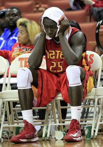 Yates Sadiq Inuwa (25) reacts on the bench in the final minute of the game during the second half of the UIL 3A boys state basketball final game between Dallas Madison and Houston Yates at the Frank Erwin Center, Saturday, March 9, 2013, in Austin.  Yates lost the game. Photo: Karen Warren, Houston Chronicle / © 2013 Houston Chronicle