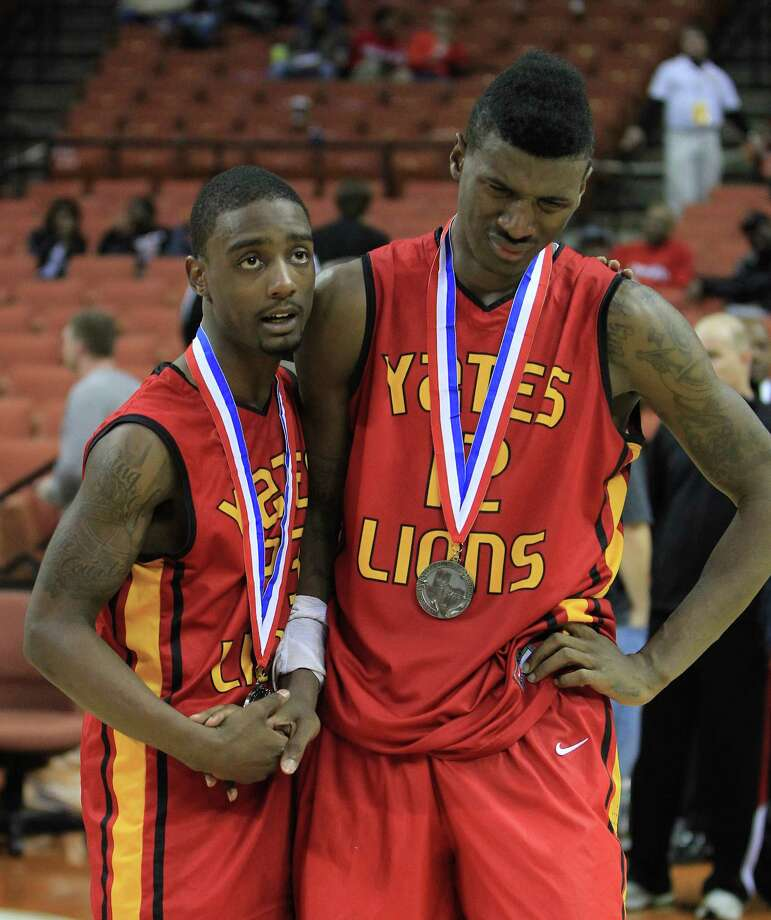 Yates Darrion Martin (23) and Melvin Swift (12) react during the awards ceremony after Yates' loss after the UIL 3A boys state basketball final game between Dallas Madison and Houston Yates at the Frank Erwin Center, Saturday, March 9, 2013, in Austin.  Yates lost the game. Photo: Karen Warren, Houston Chronicle / © 2013 Houston Chronicle