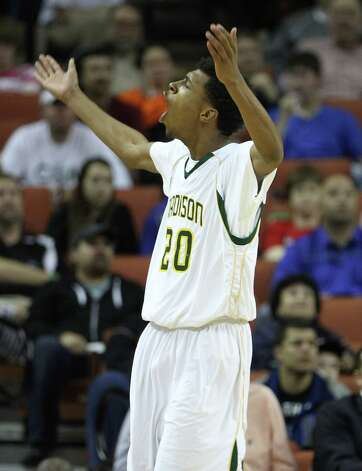 Dallas Madison's Devonte Robinson (20) reacts after a basket during the second half of the UIL 3A boys state basketball final game between Dallas Madison and Houston Yates at the Frank Erwin Center, Saturday, March 9, 2013, in Austin.  Yates lost the game. Photo: Karen Warren, Houston Chronicle / © 2013 Houston Chronicle